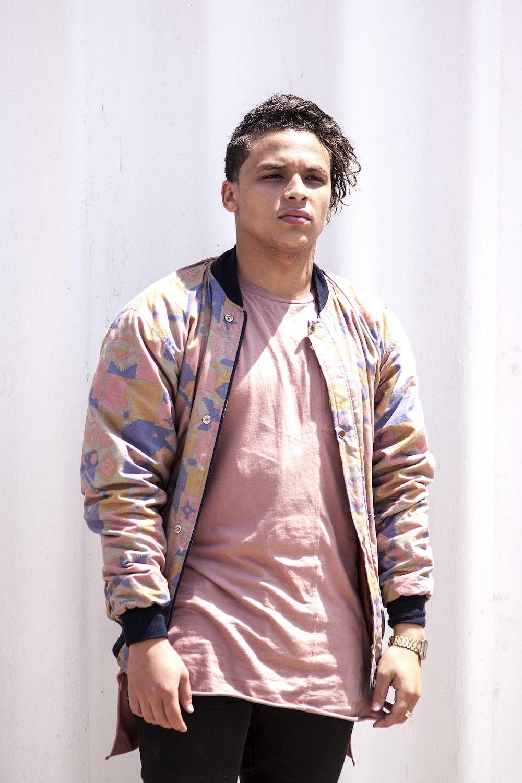 men in pink and brown zip-up jacket standing