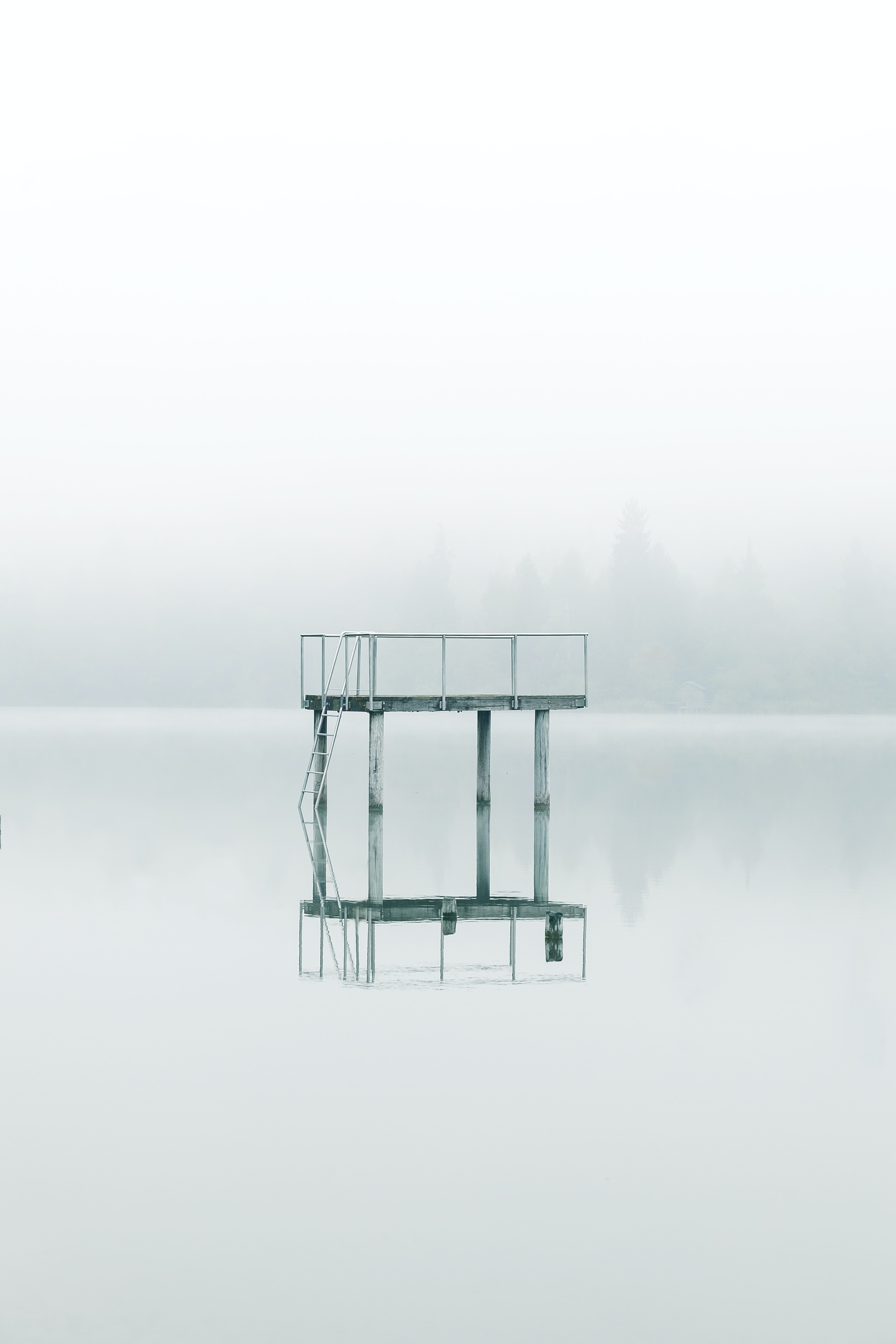 photography gray metal tower near body of water during daytime