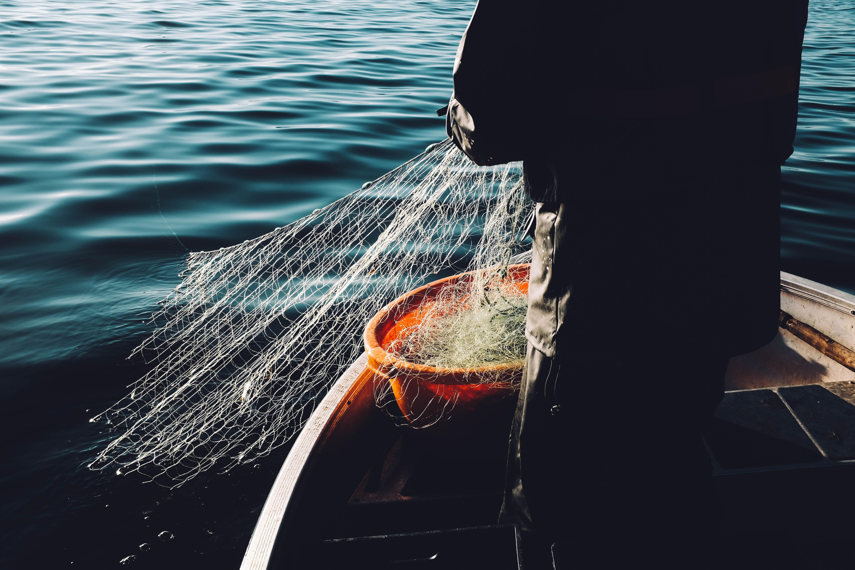 man holding a fishnet