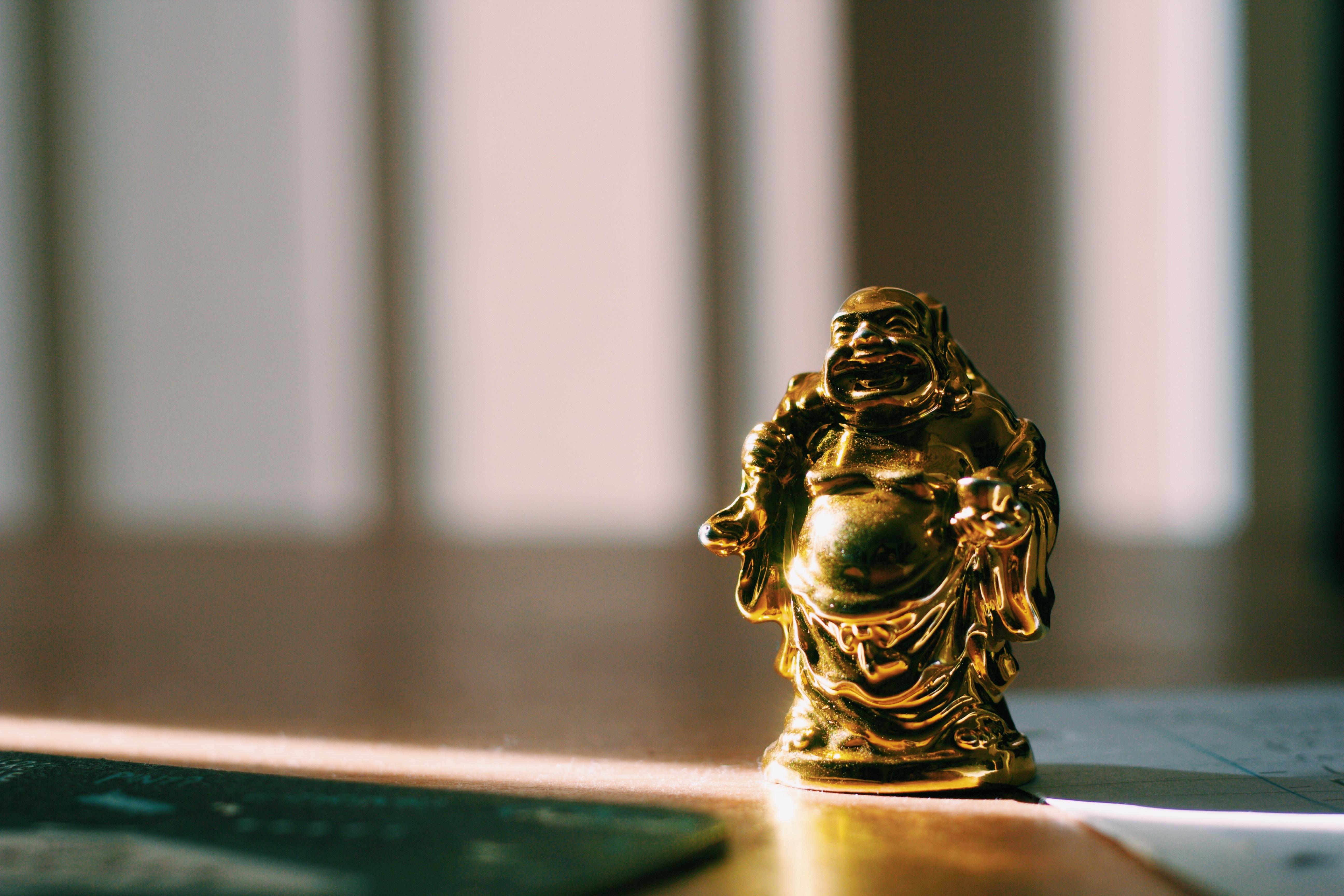 gold Buddha figurine on floor