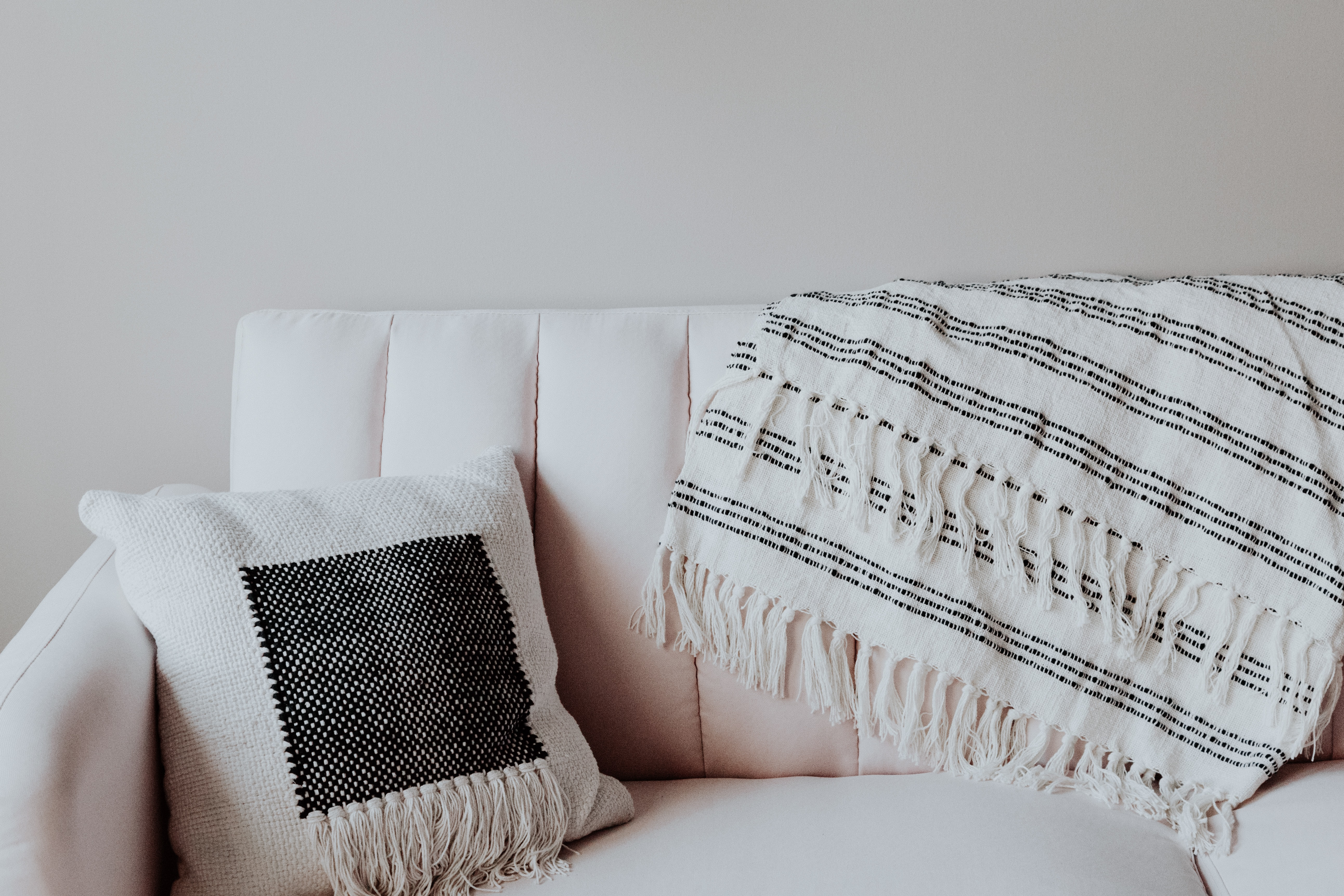 white and black throw pillow