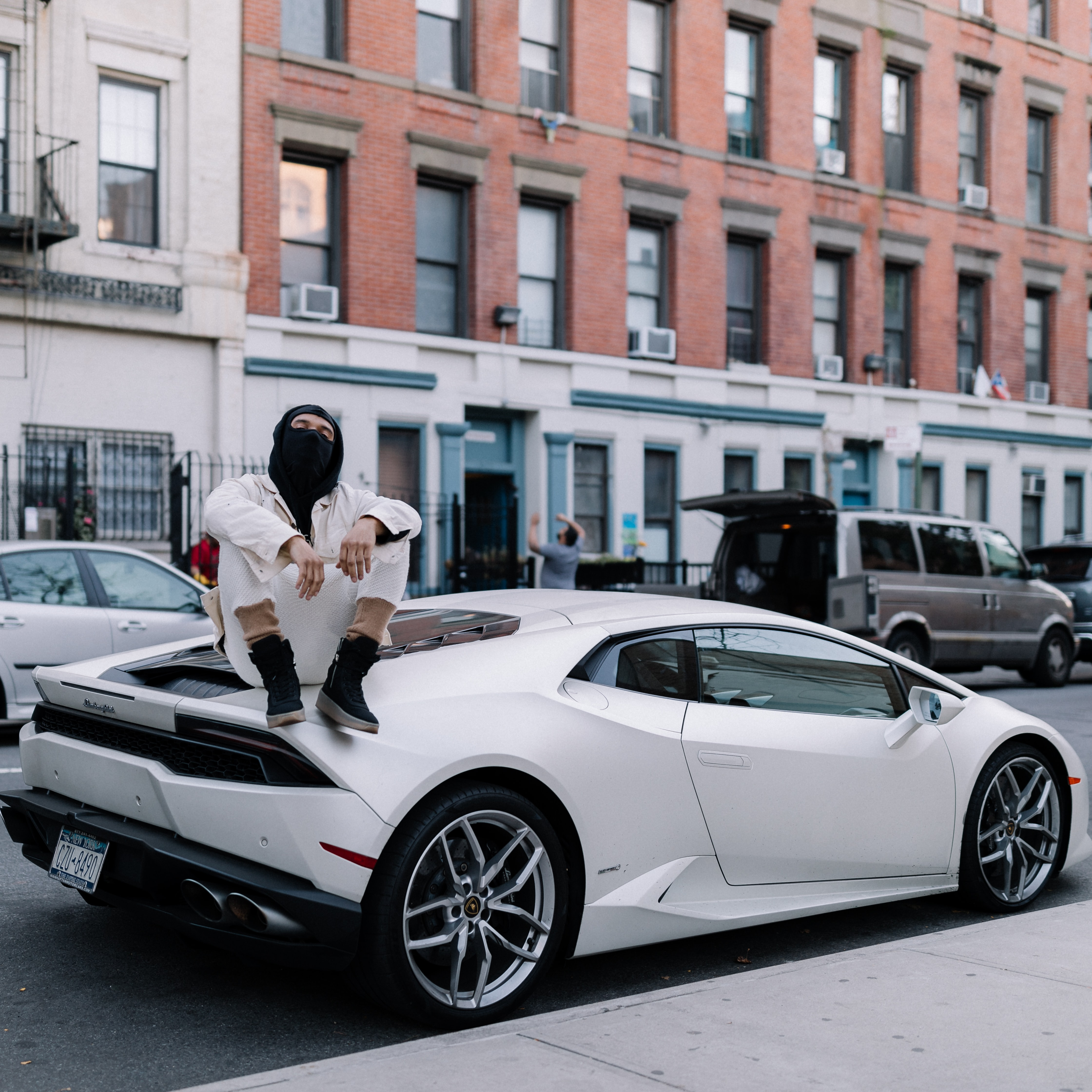 man sitting on white coupe