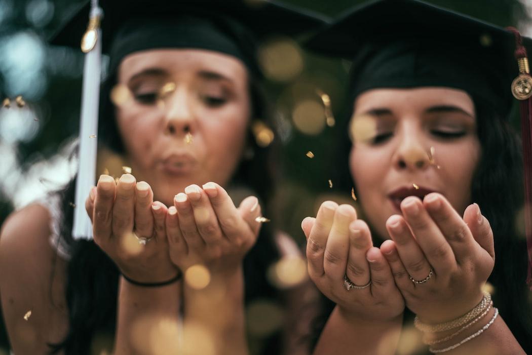 Two women in graduation gear