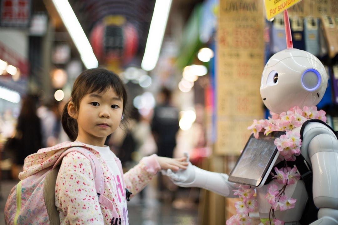 As Kuromon Market in Osaka was about to close for the evening I sampled some delicious king crab and did a final lap of the market when I stumbled upon one of the most Japanese scenes I could possibly imagine, a little girl, making friends with a robot.
