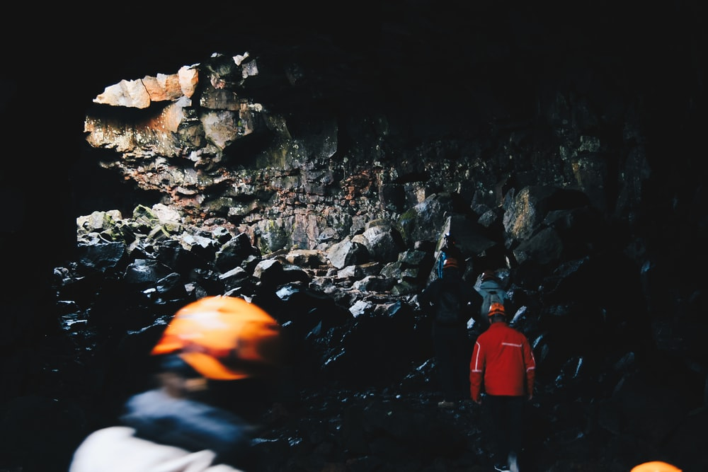 person standing inside the cave