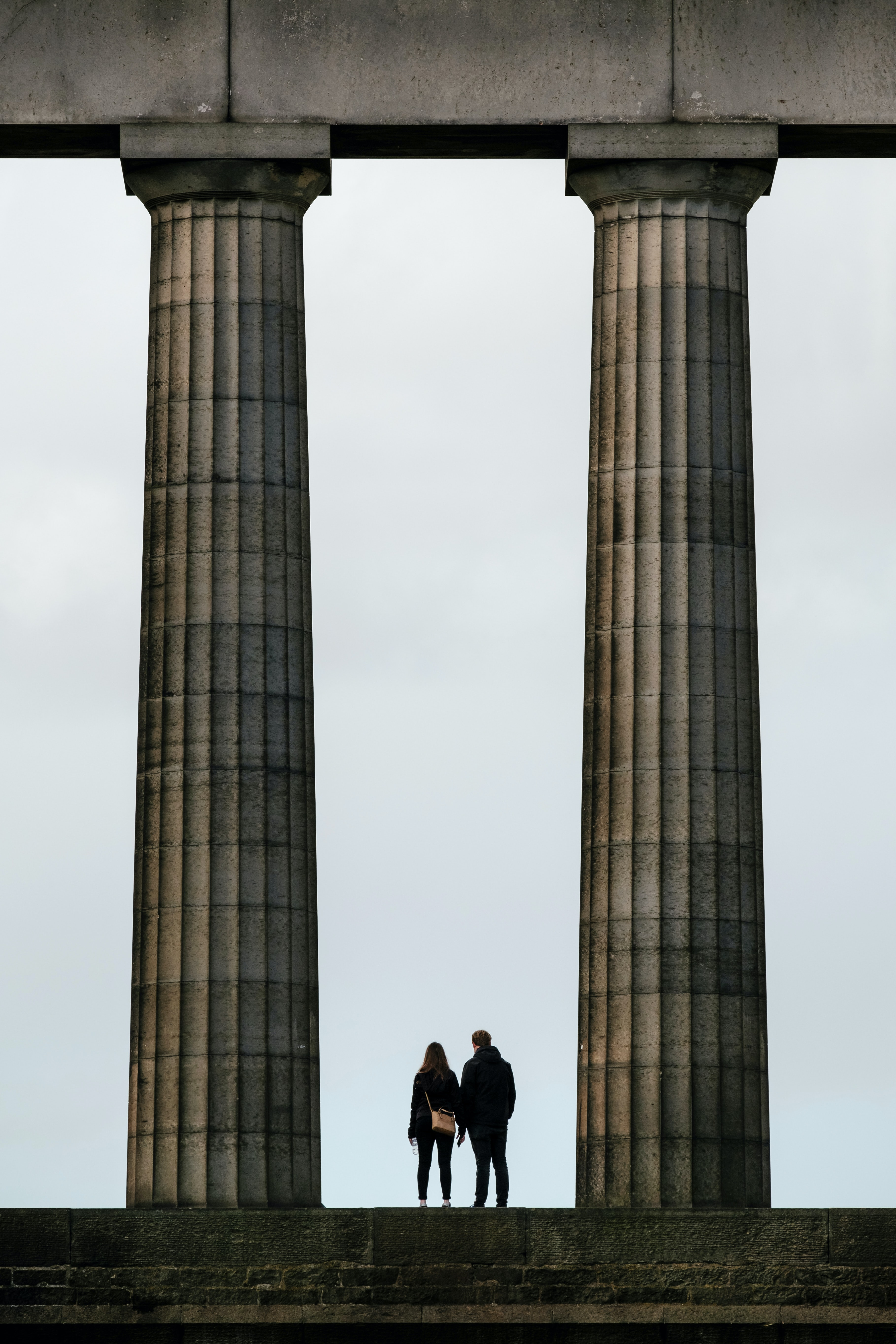 man and woman standing near monument
