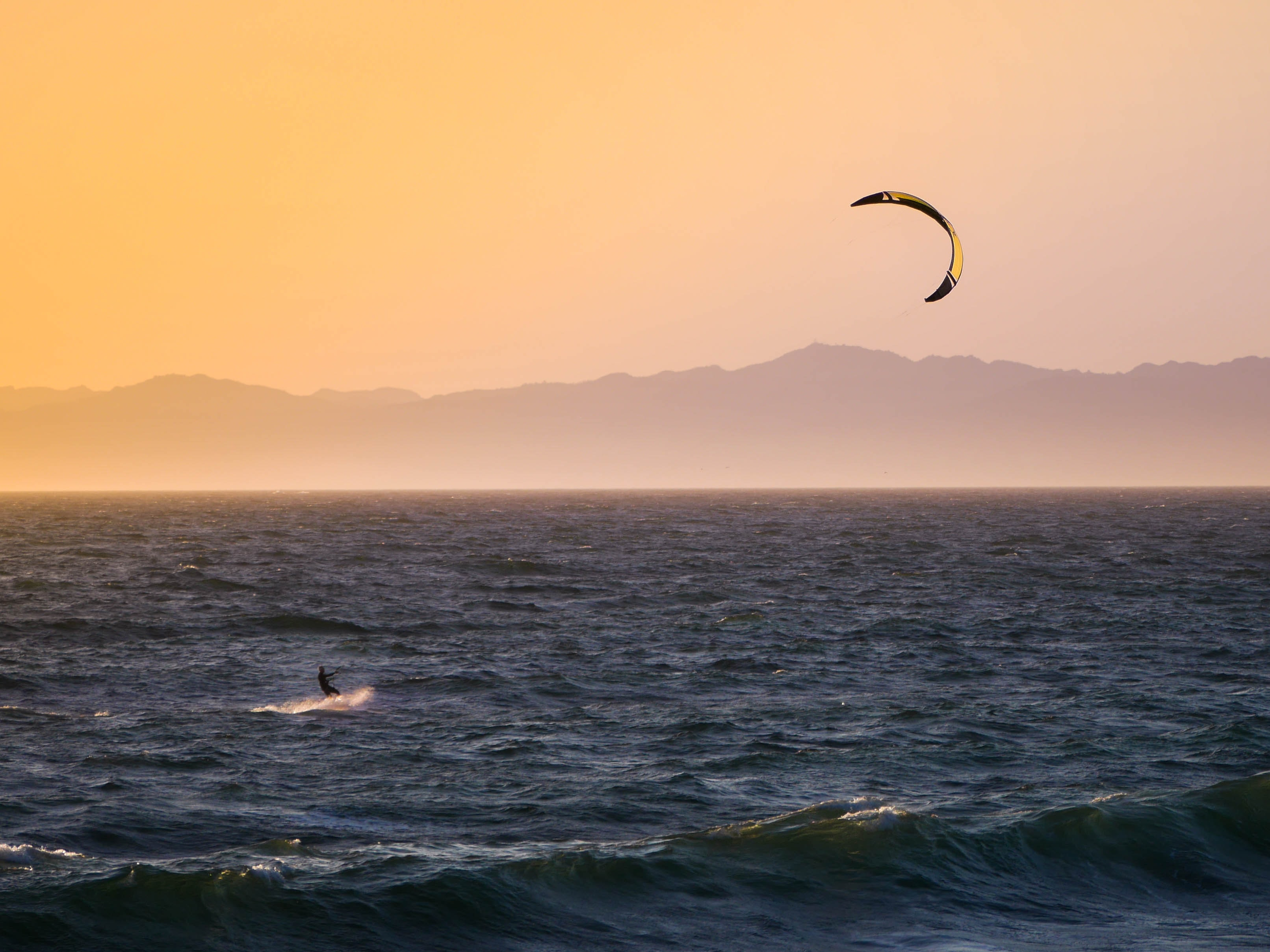 kitesurfing during golden hour