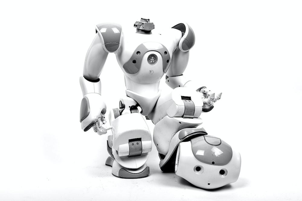 white and gray RoboSapien in white background
