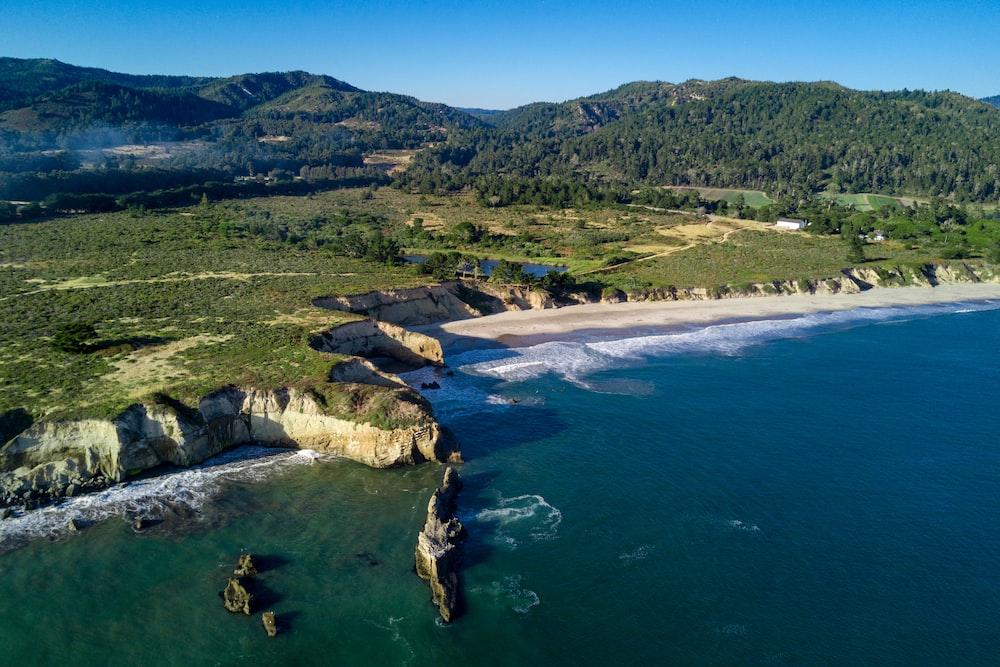 bird's eye view photo of cliff near beach