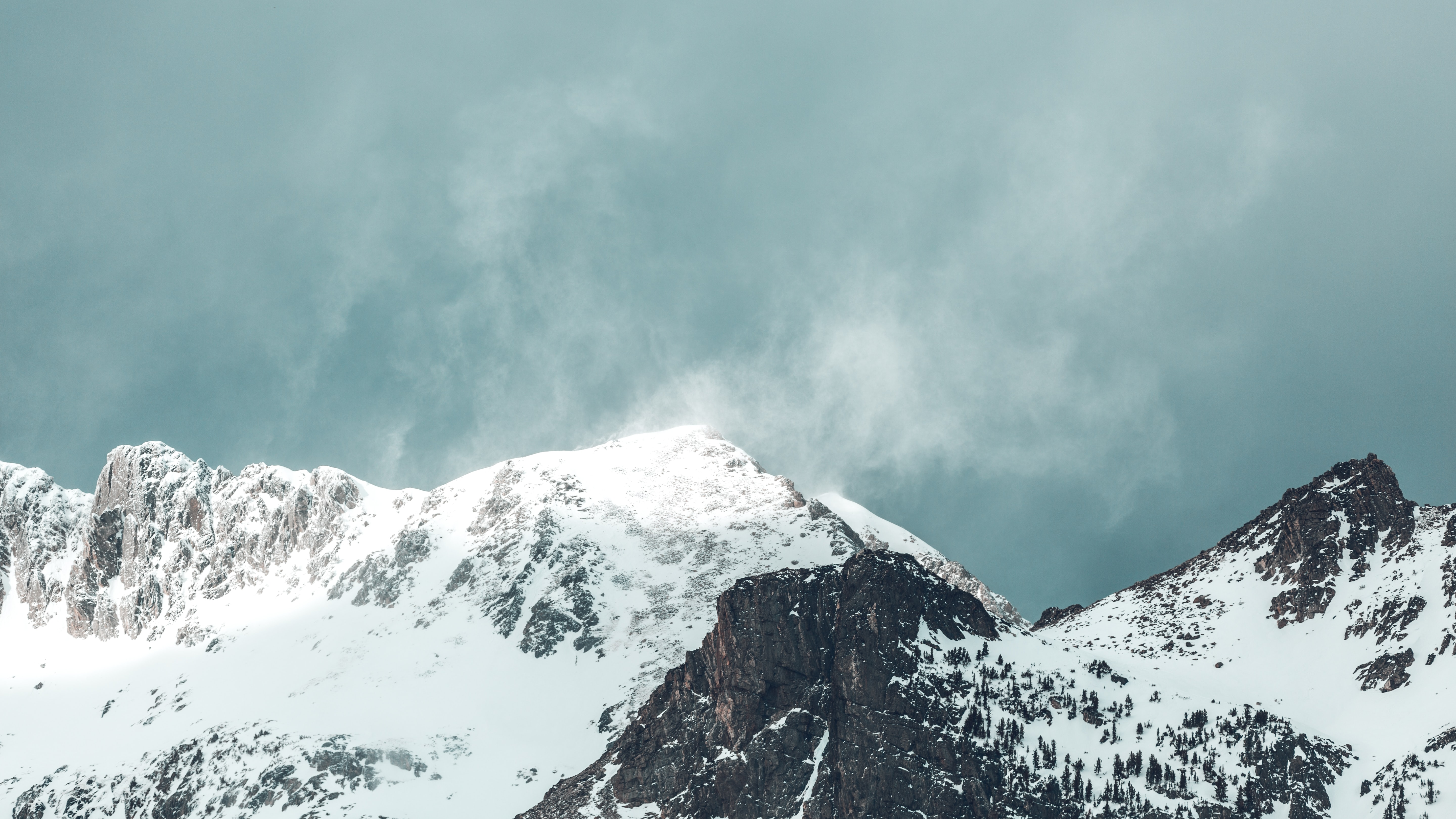 gray mountain covered with snow