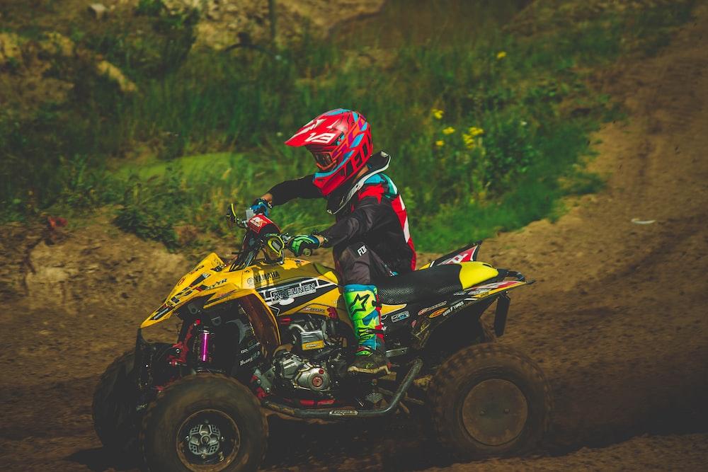 man riding ATV during daytime