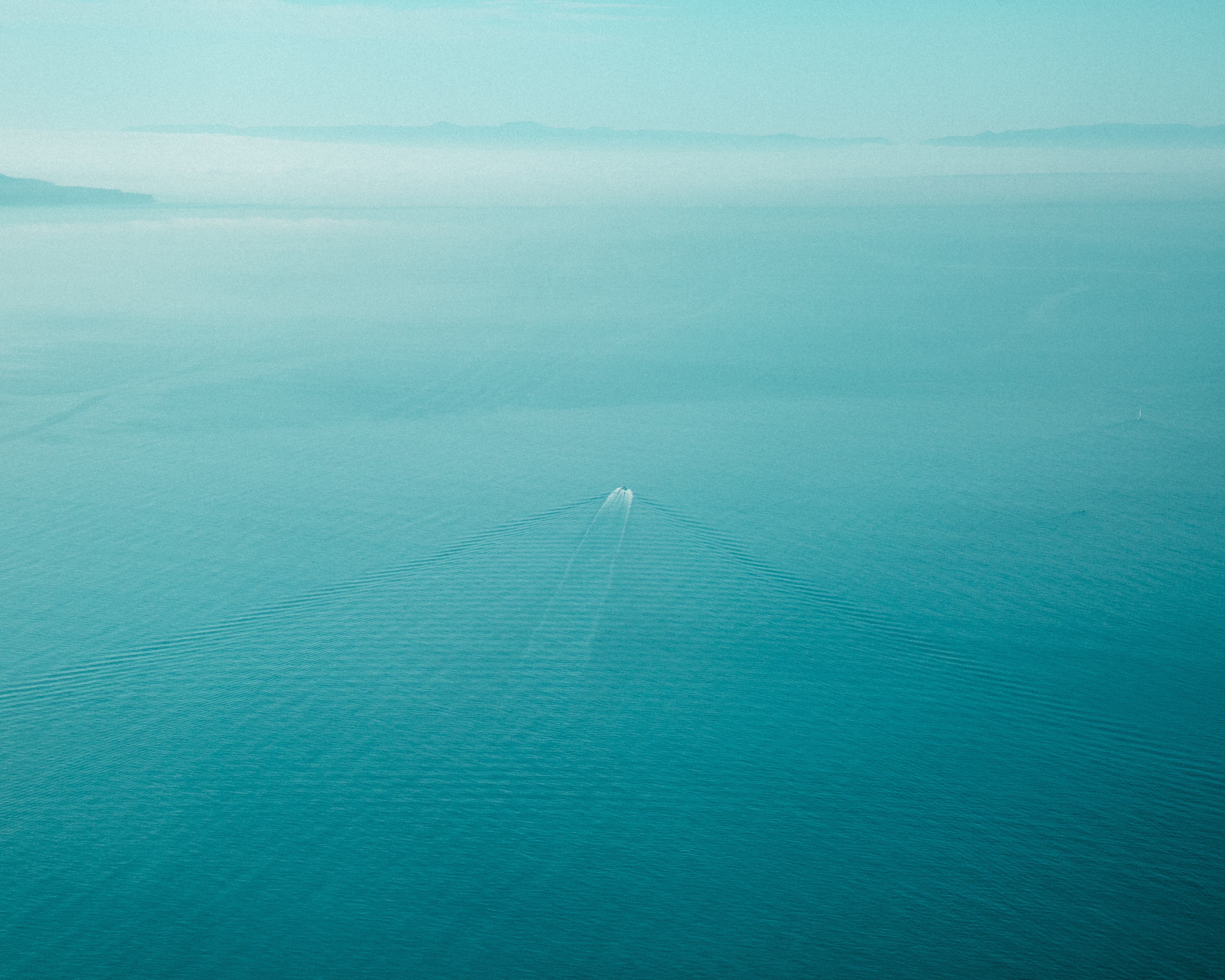 boat sailing through calm waters