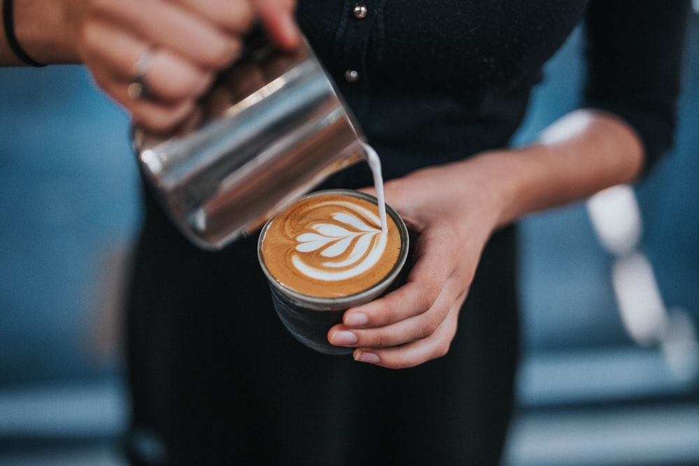 person holding coffee with latte cup