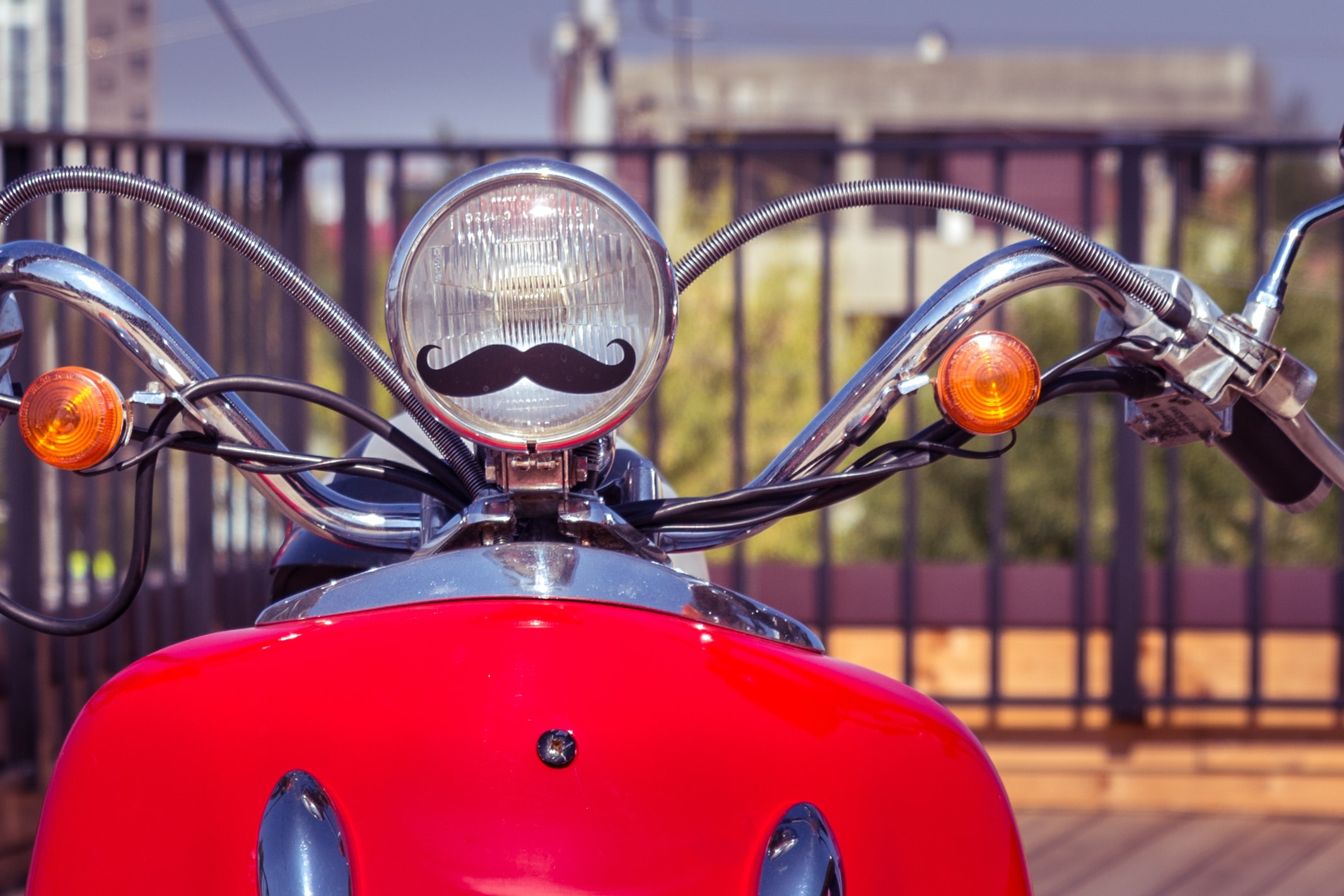 focus photography of red motorcycle