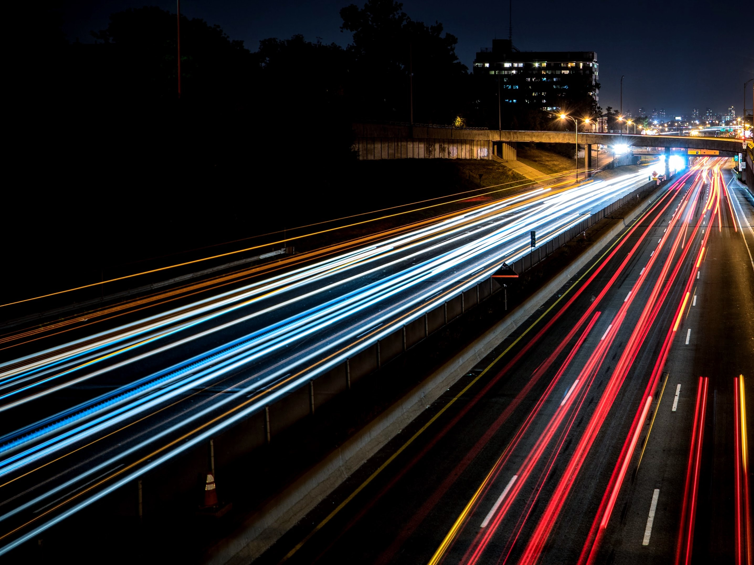 time-lapse photography of cars passing through the road during night time