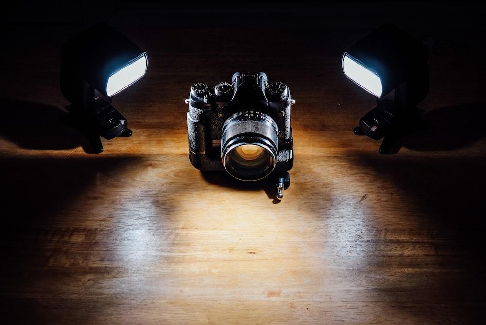 black DSLR camera in dark room