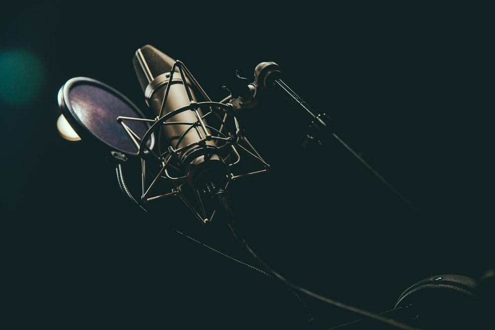 bokeh photography of condenser microphone