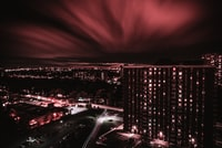 aerial photograph of high rise buildings under red sky