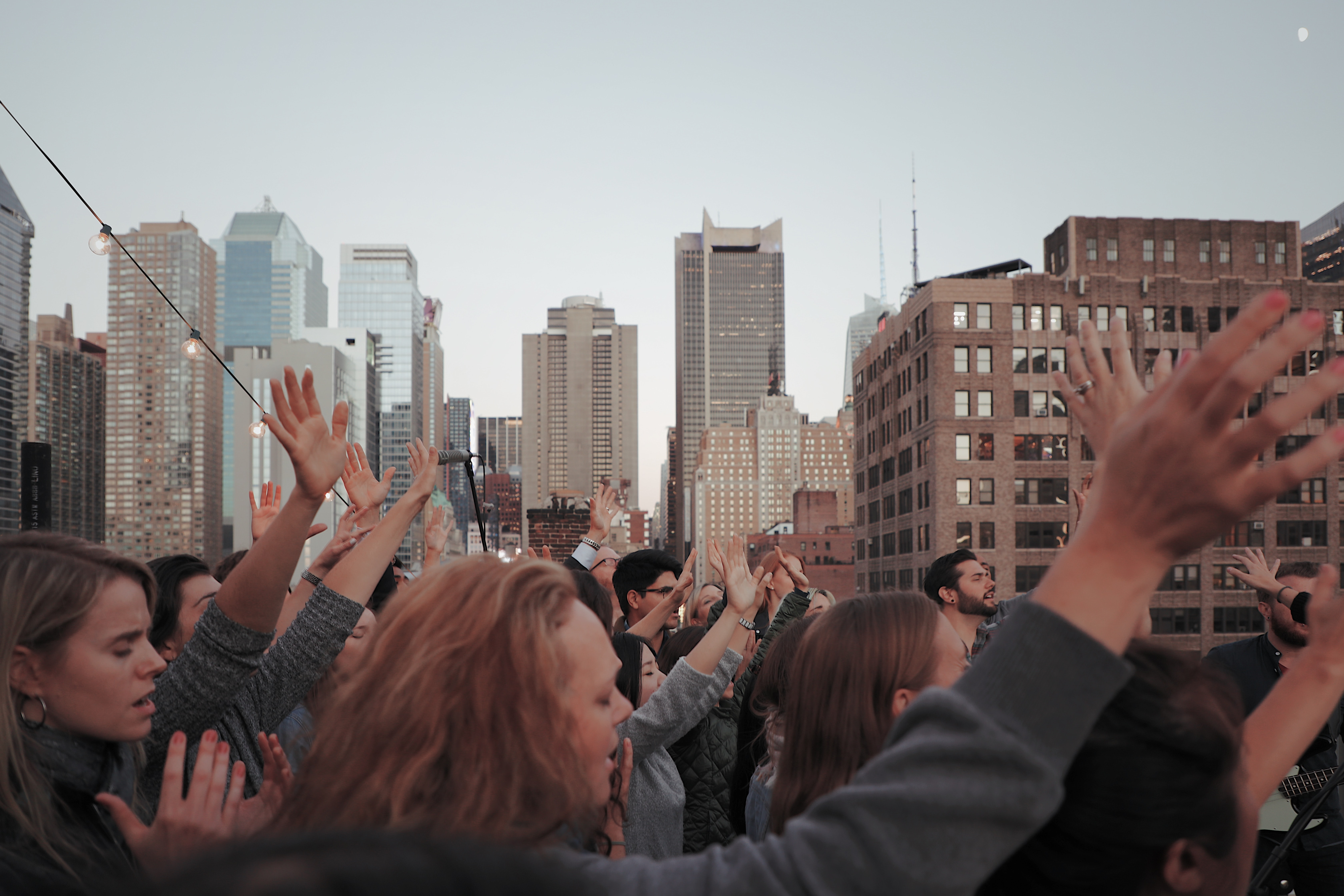 group of people waving their hands