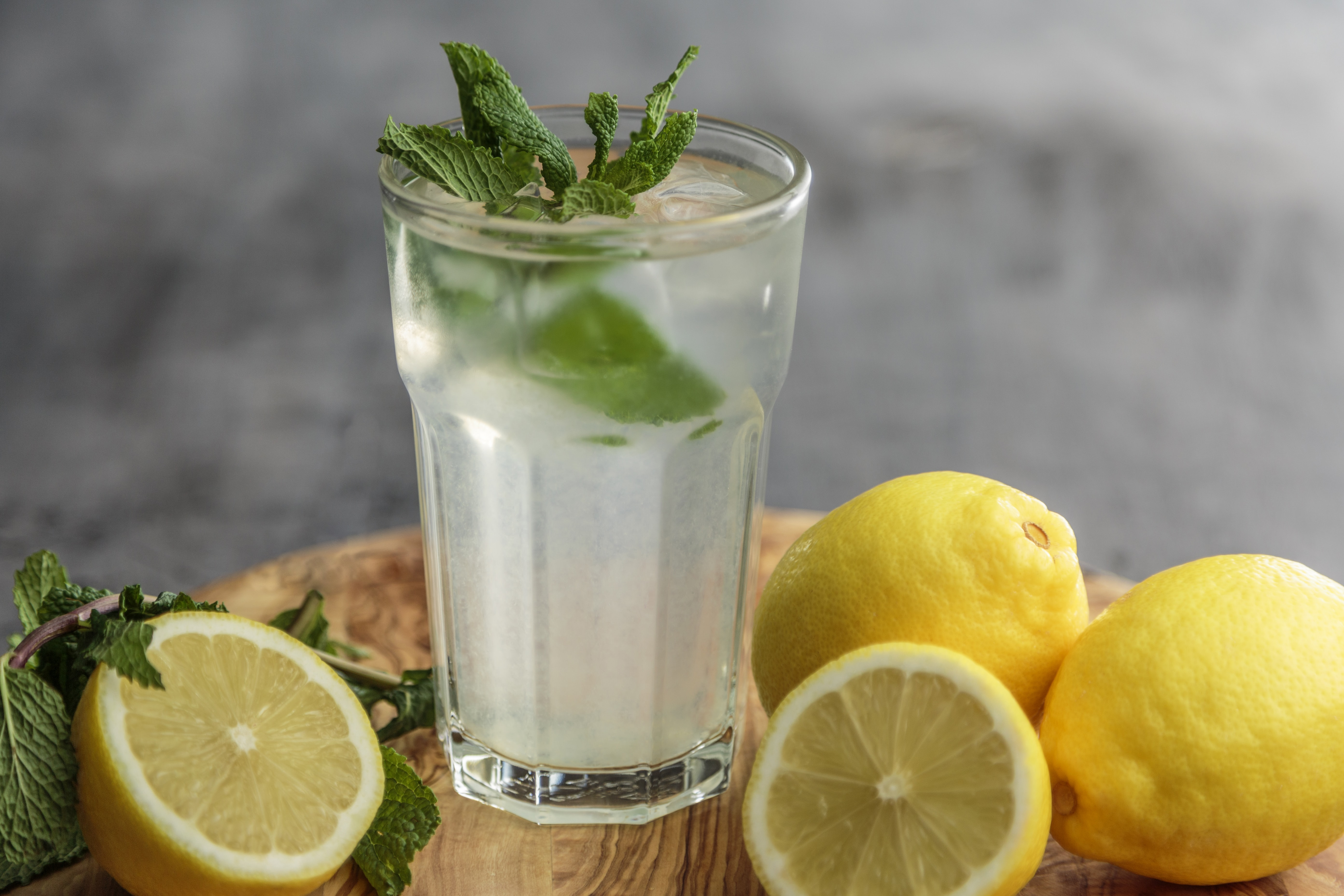 lime juice on drinking glass beside sliced limes