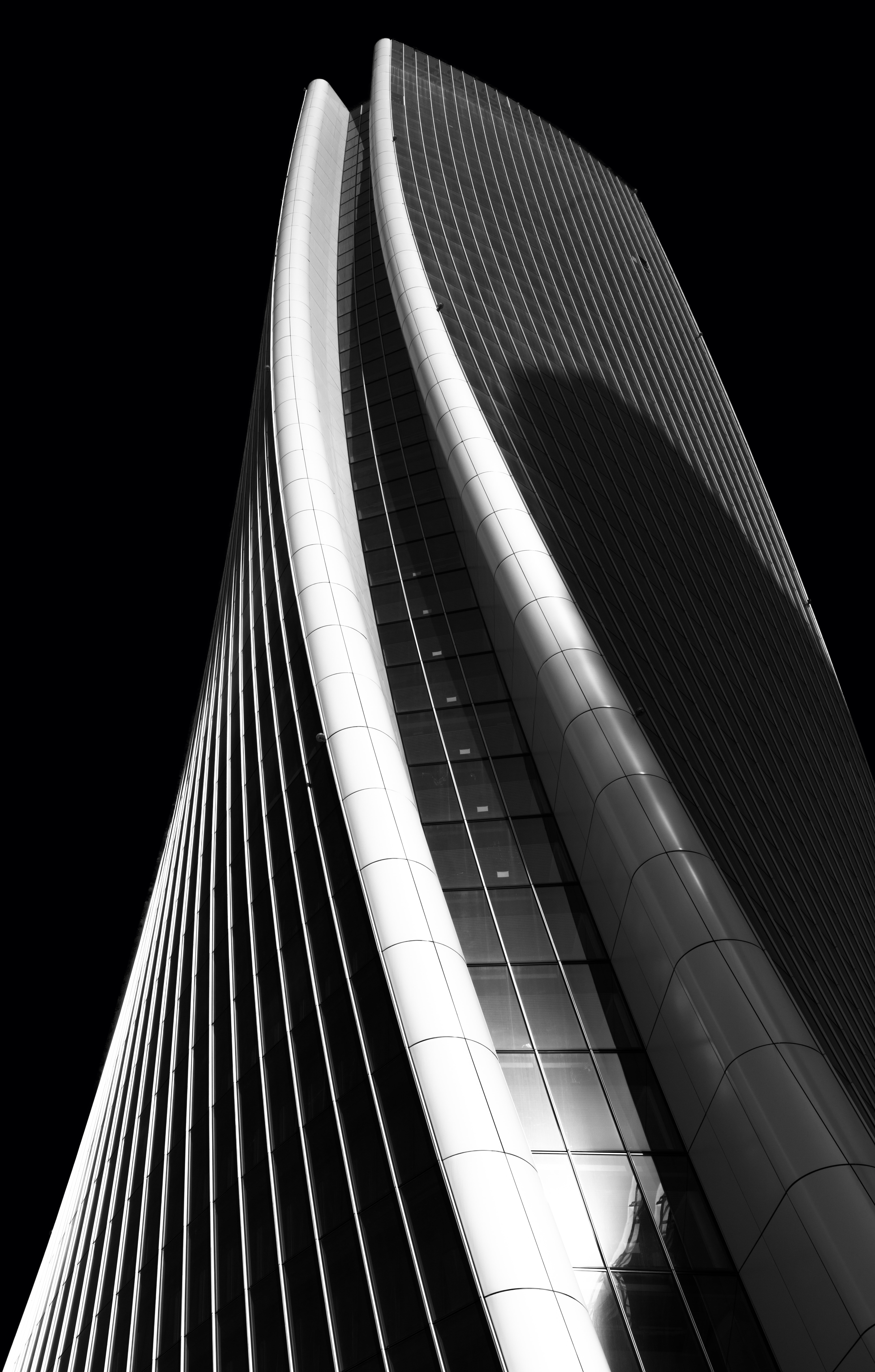 high-rise curtained wall building grayscale photography