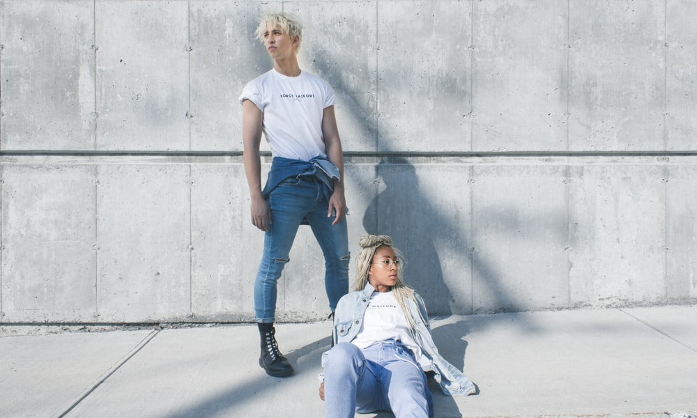 woman and man posing for photoshoot