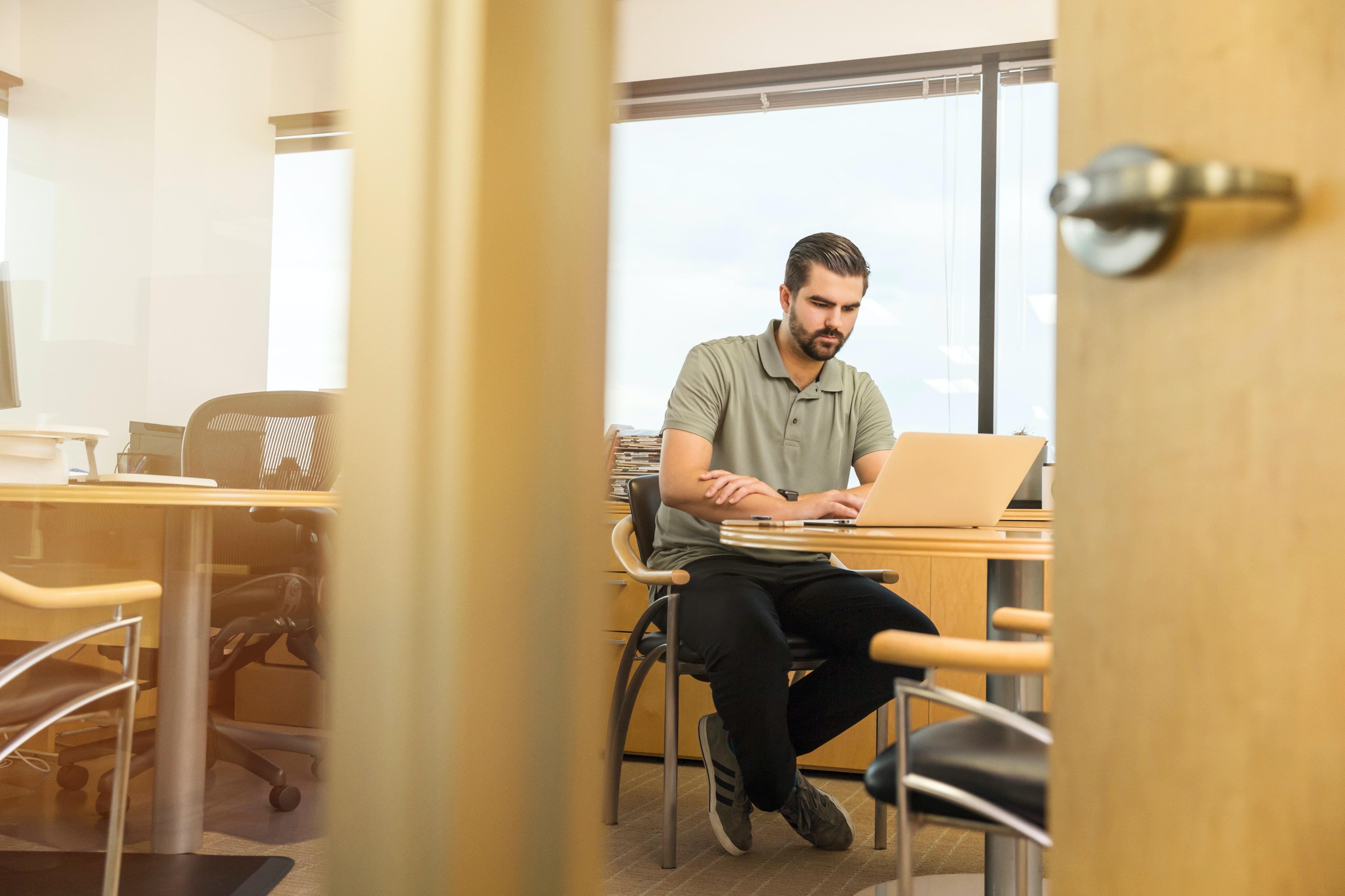 man sitting near desk