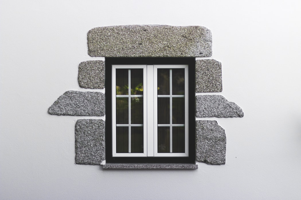 image of small window with stone siding