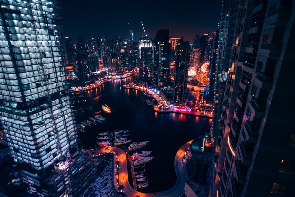aerial view of high rise buildings during night time