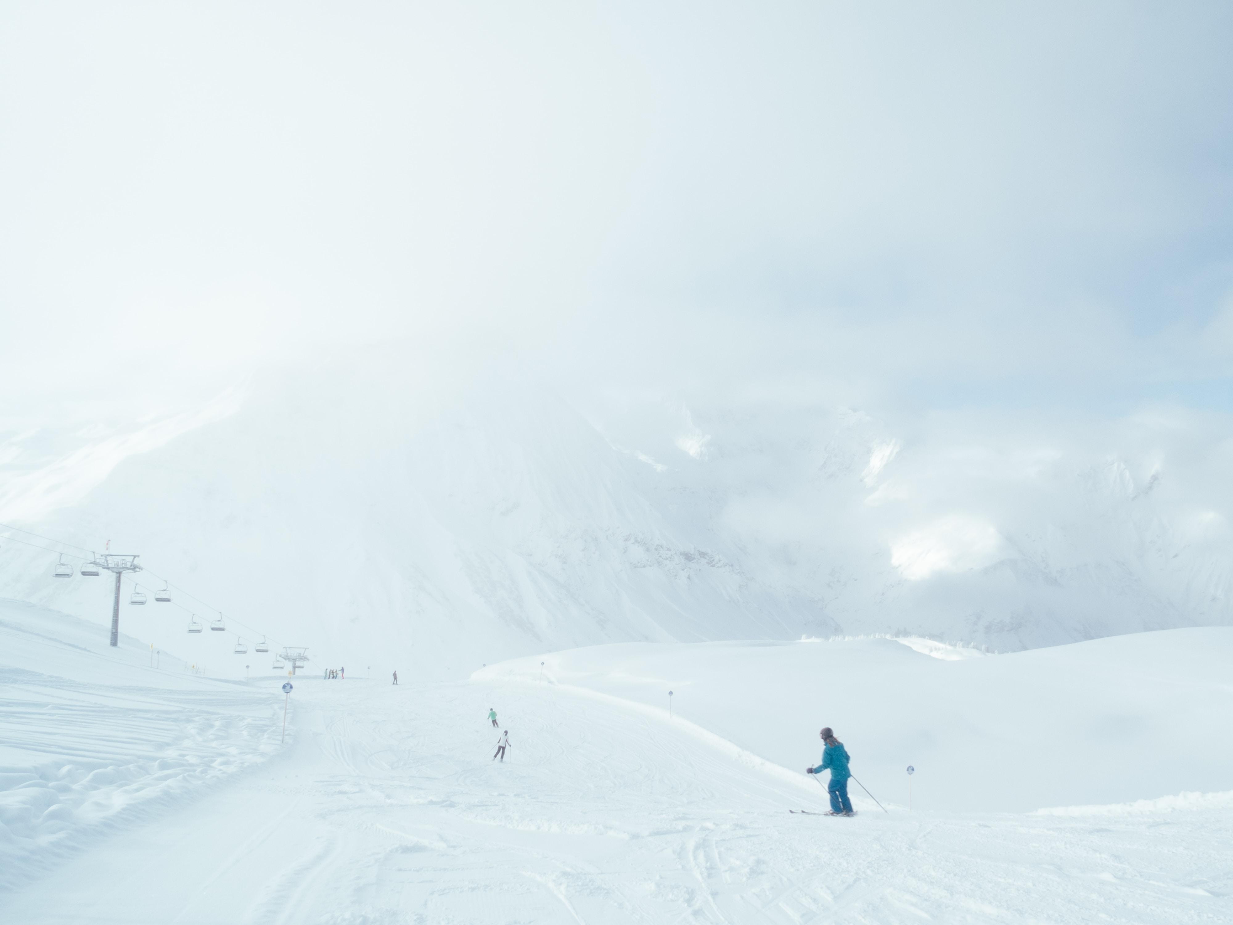 person walking on the snowy field