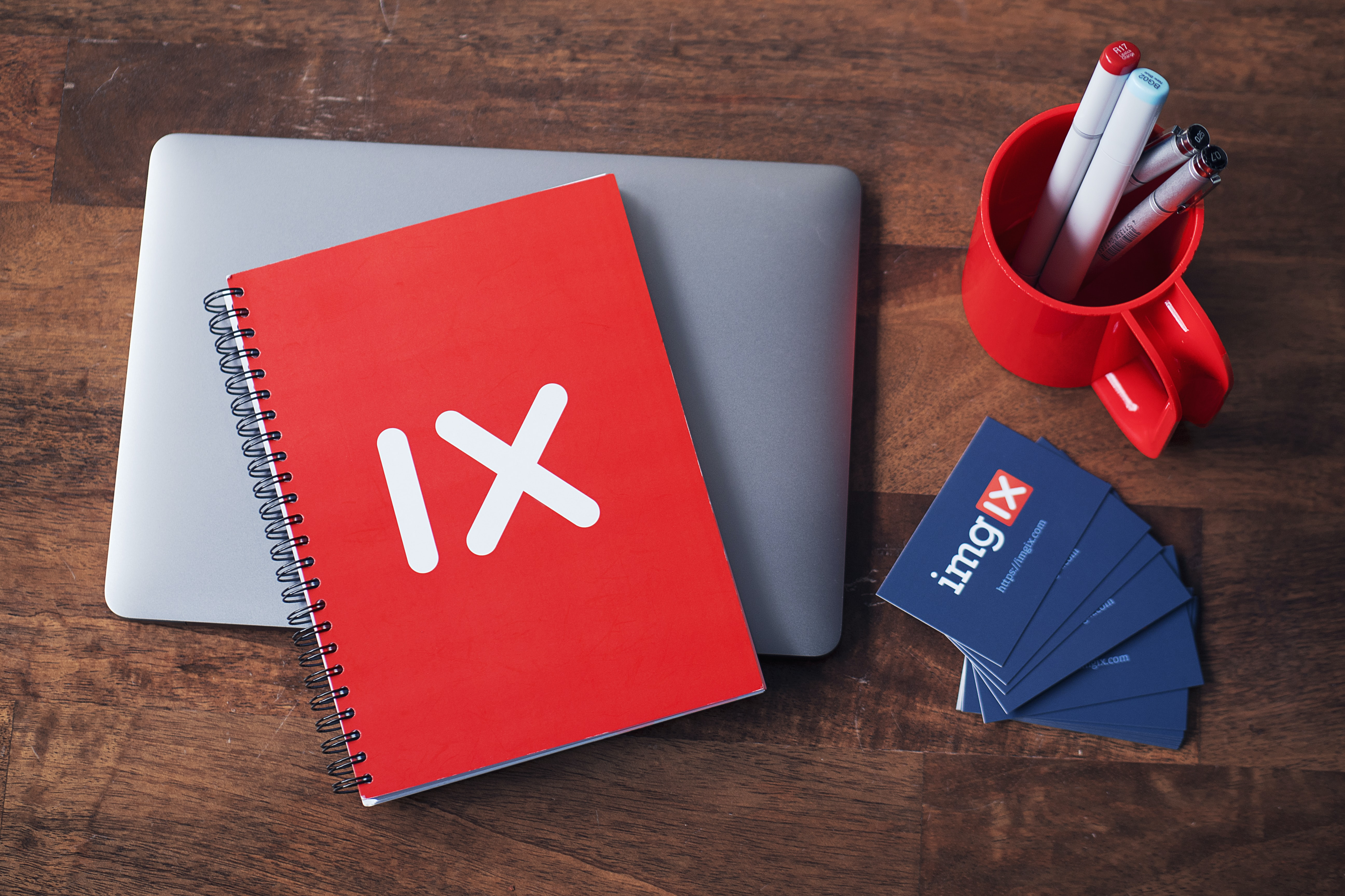 red spiral notebook in flat lay photography