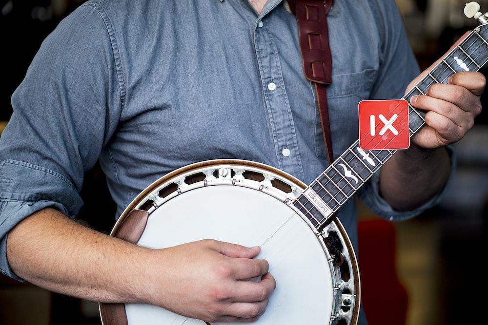 man playing banjo guitar