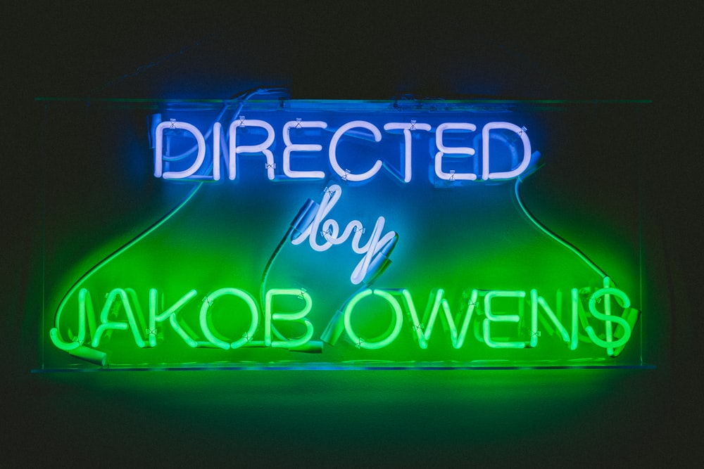 Directed by Jakob Owens neon signage