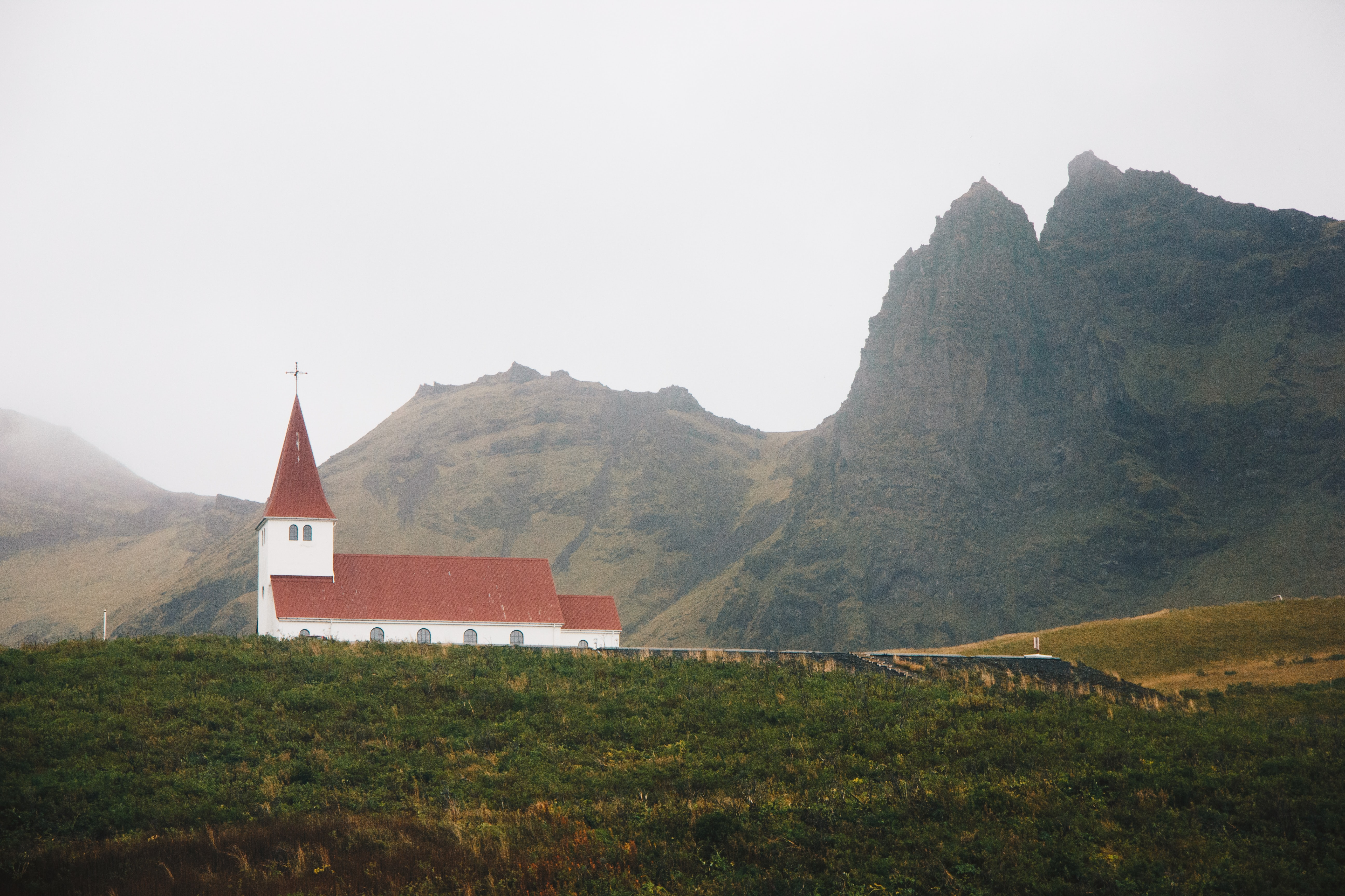 red and white church near mountain