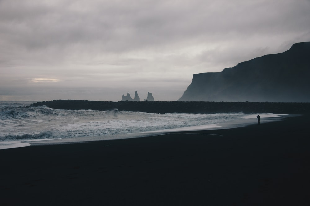 person walking at shore