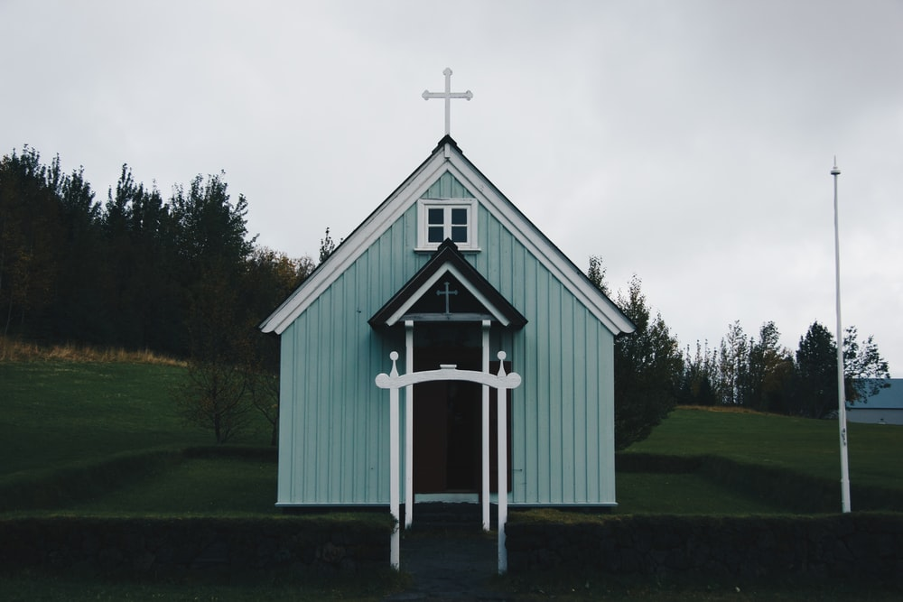 photography of green and white chapel during daytime