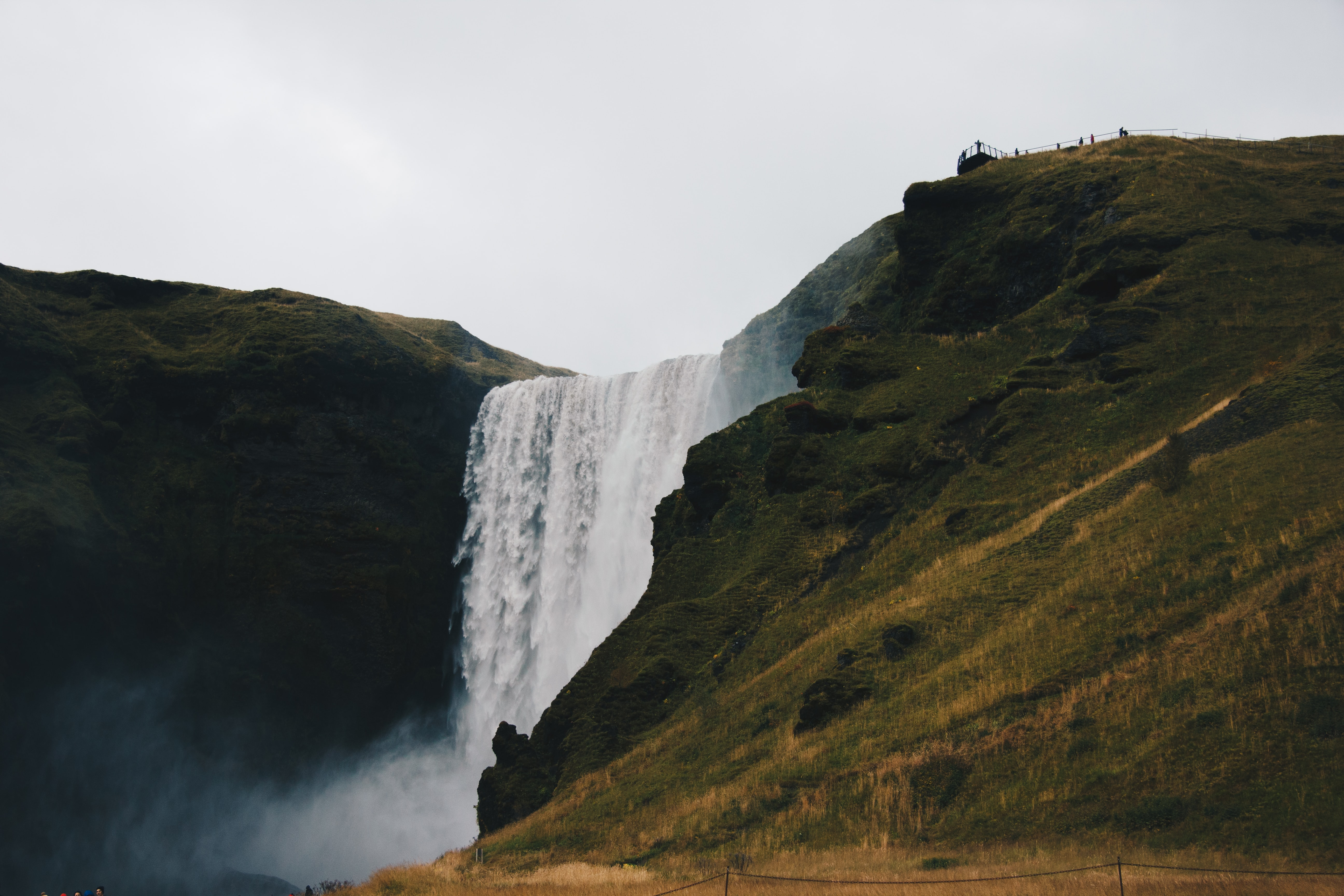 landscape photography of water falls and mountains