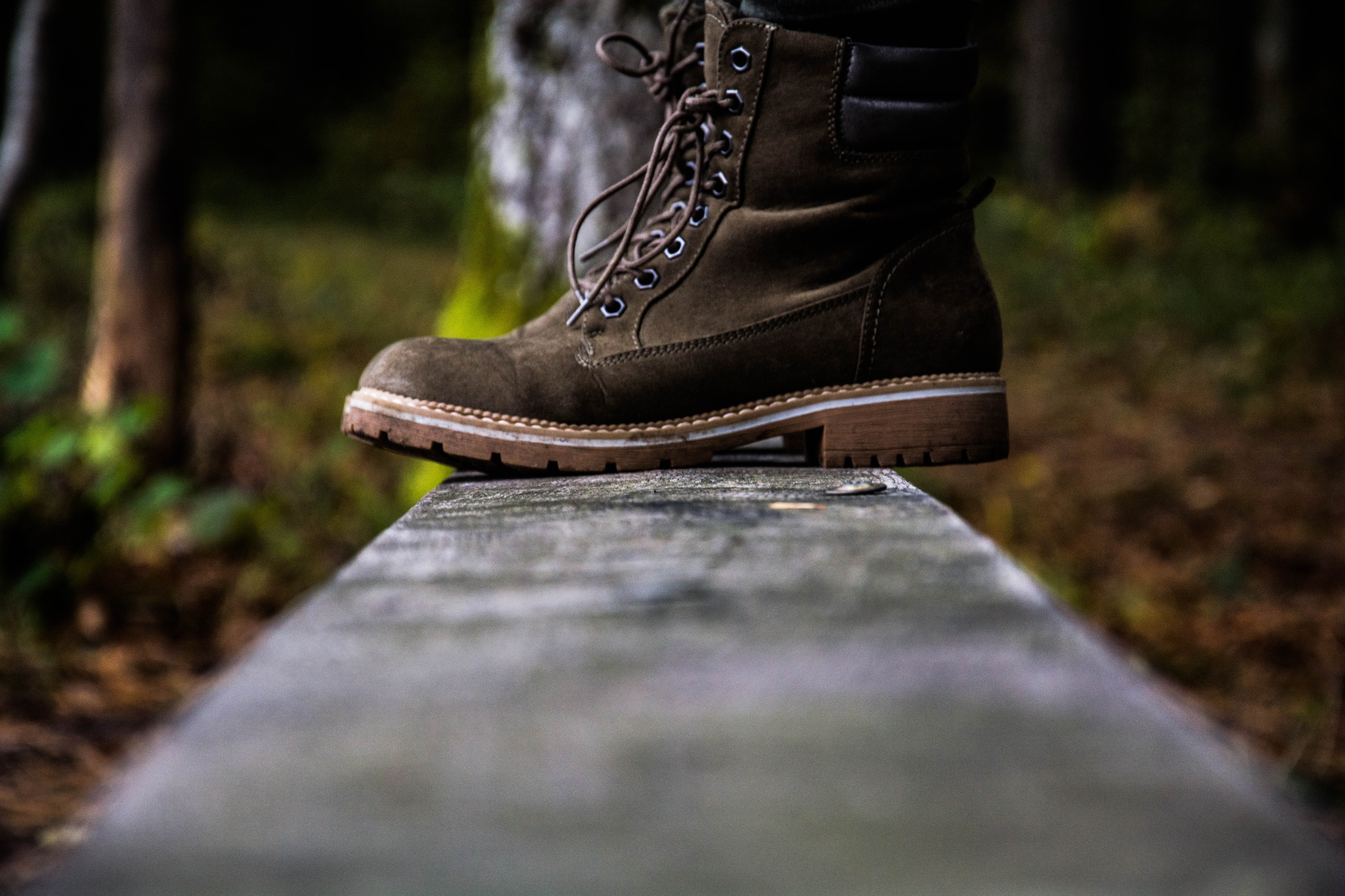 low angle photo of pair of brown suede work boots