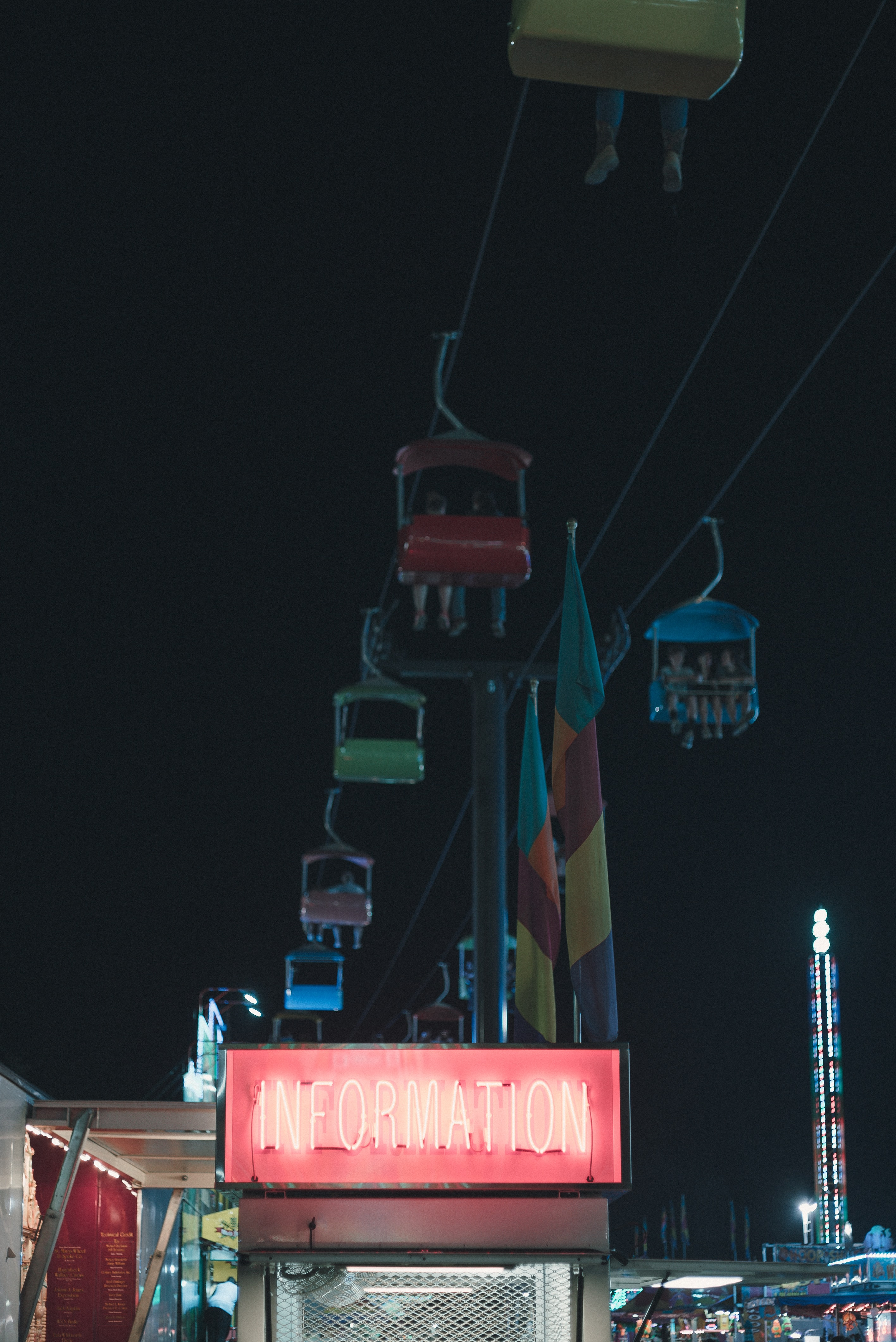 low-angle photography of cable car in amusement park during night time