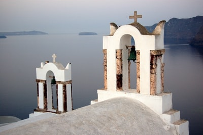 white and brow church roof during daytime mediterranean teams background
