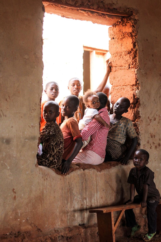 children sitting on window