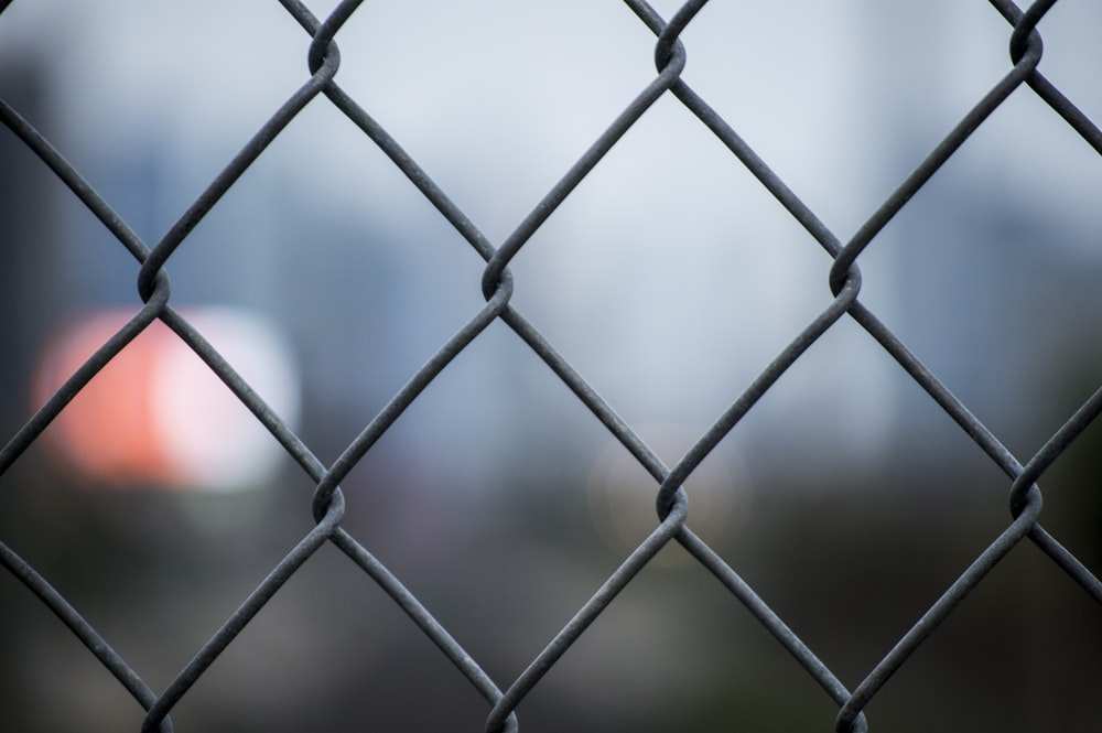 selective focus photo of chain link fence
