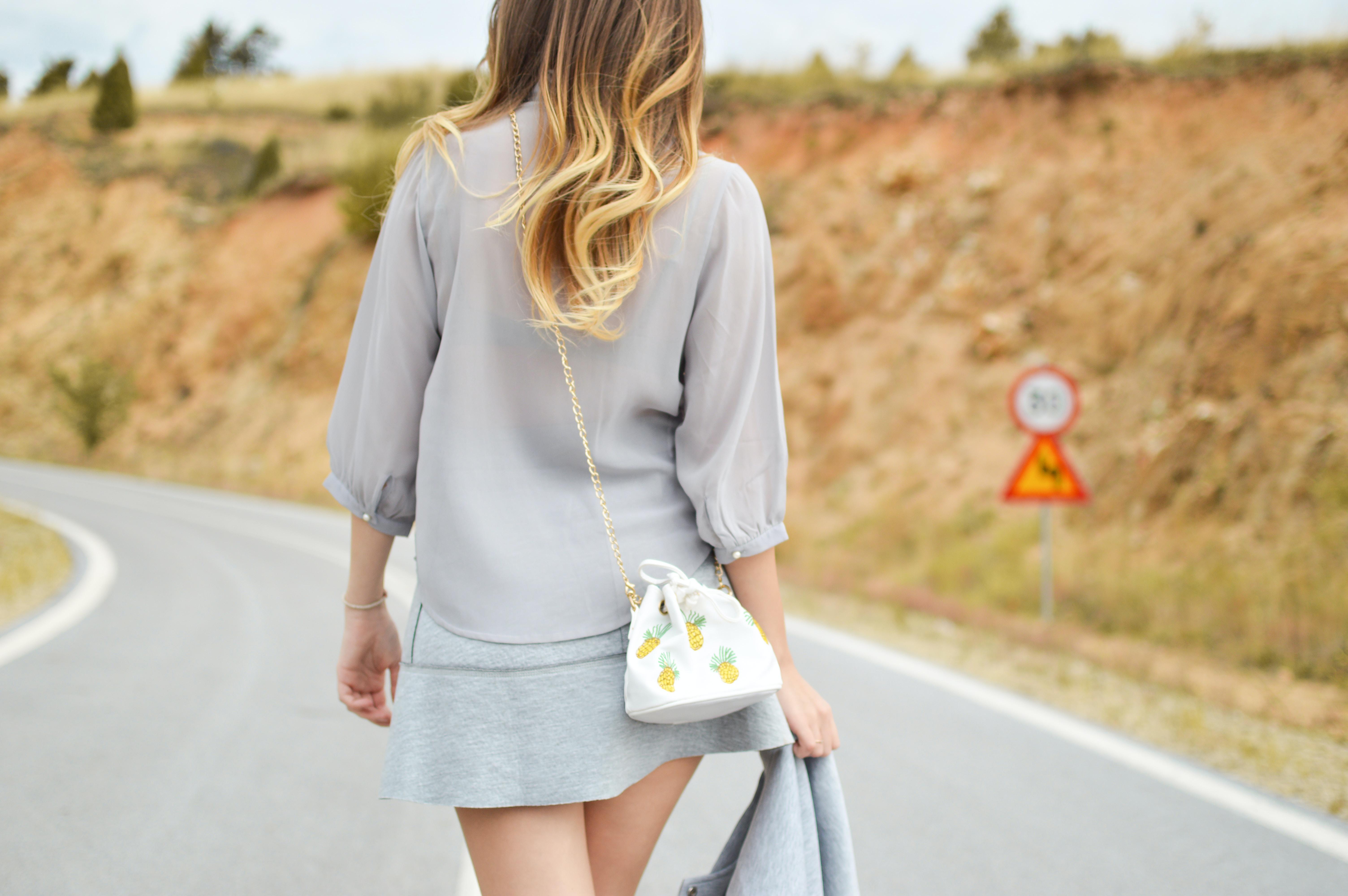 woman walk on concrete road