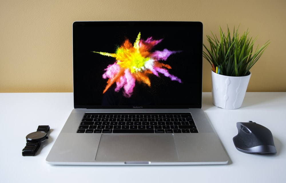 MacBook Pro showing purple illustration