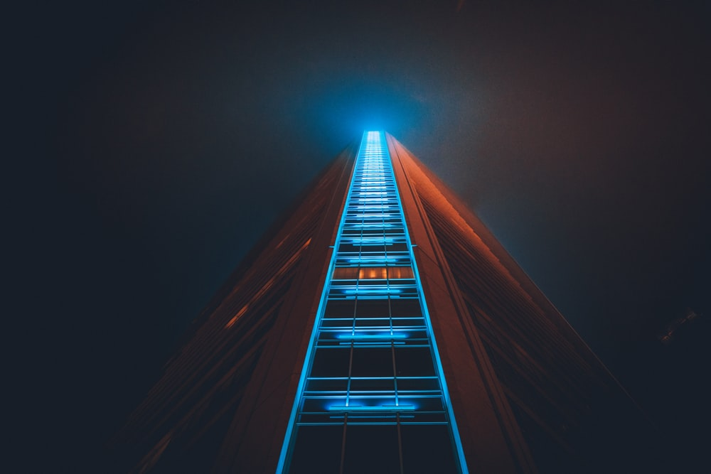 low angle photography of high rise building with lights on