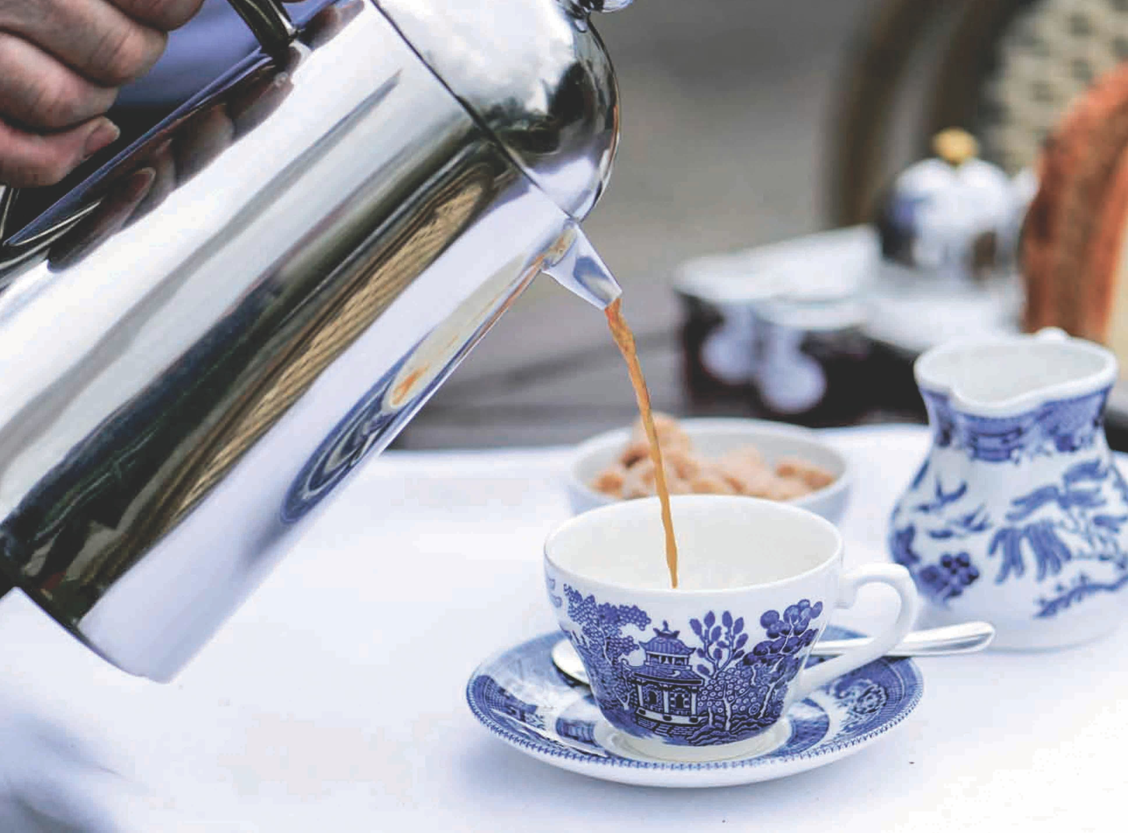white and blue tea cup with saucer