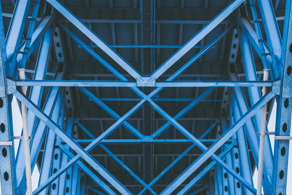 worm's eye view of blue steel structure