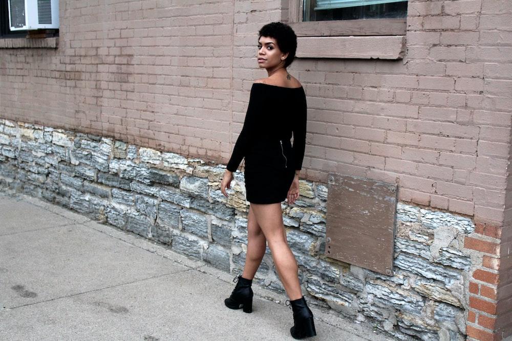 woman walking near wall