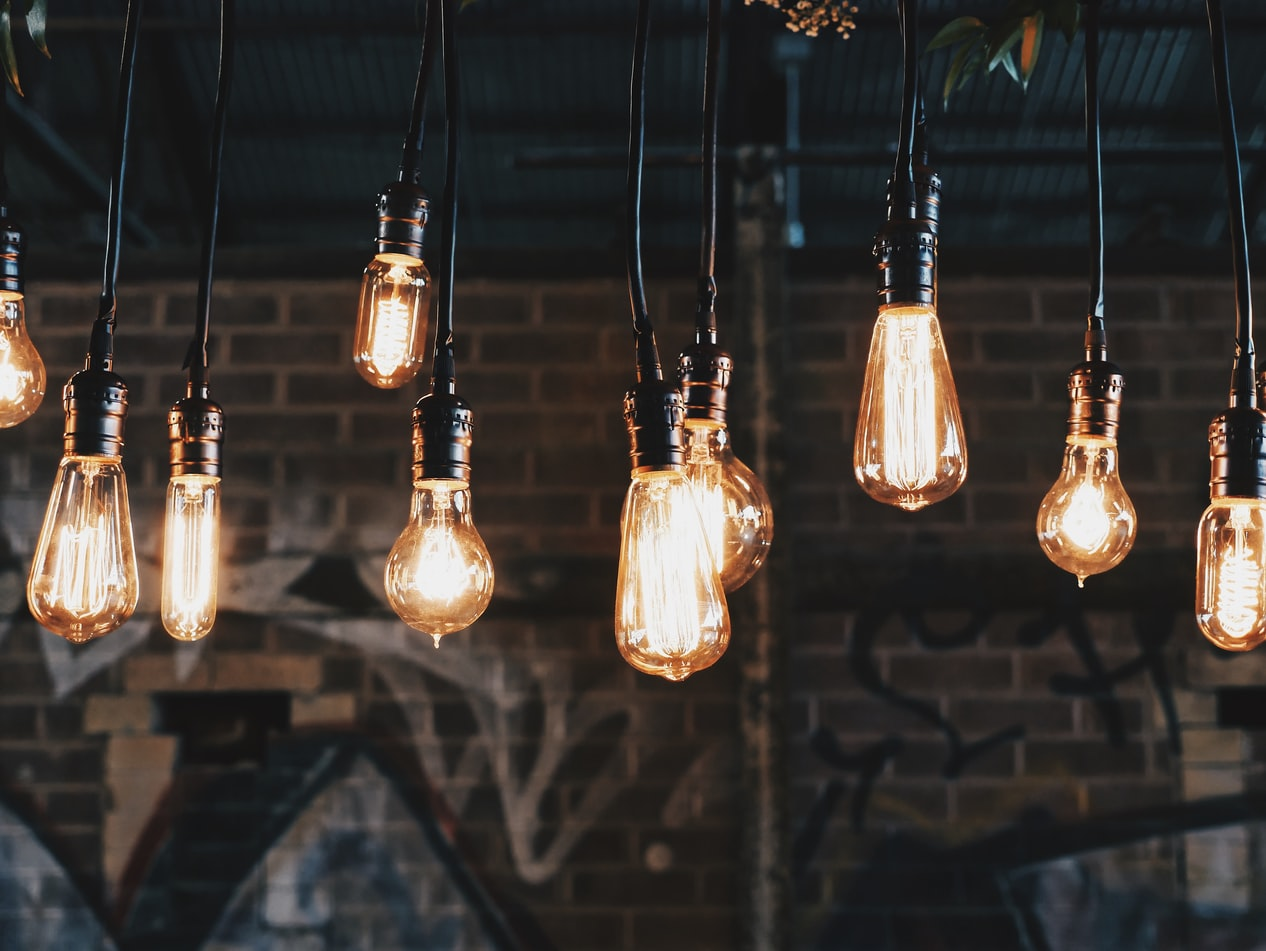 Lightbulbs glowing in a brick warehouse.