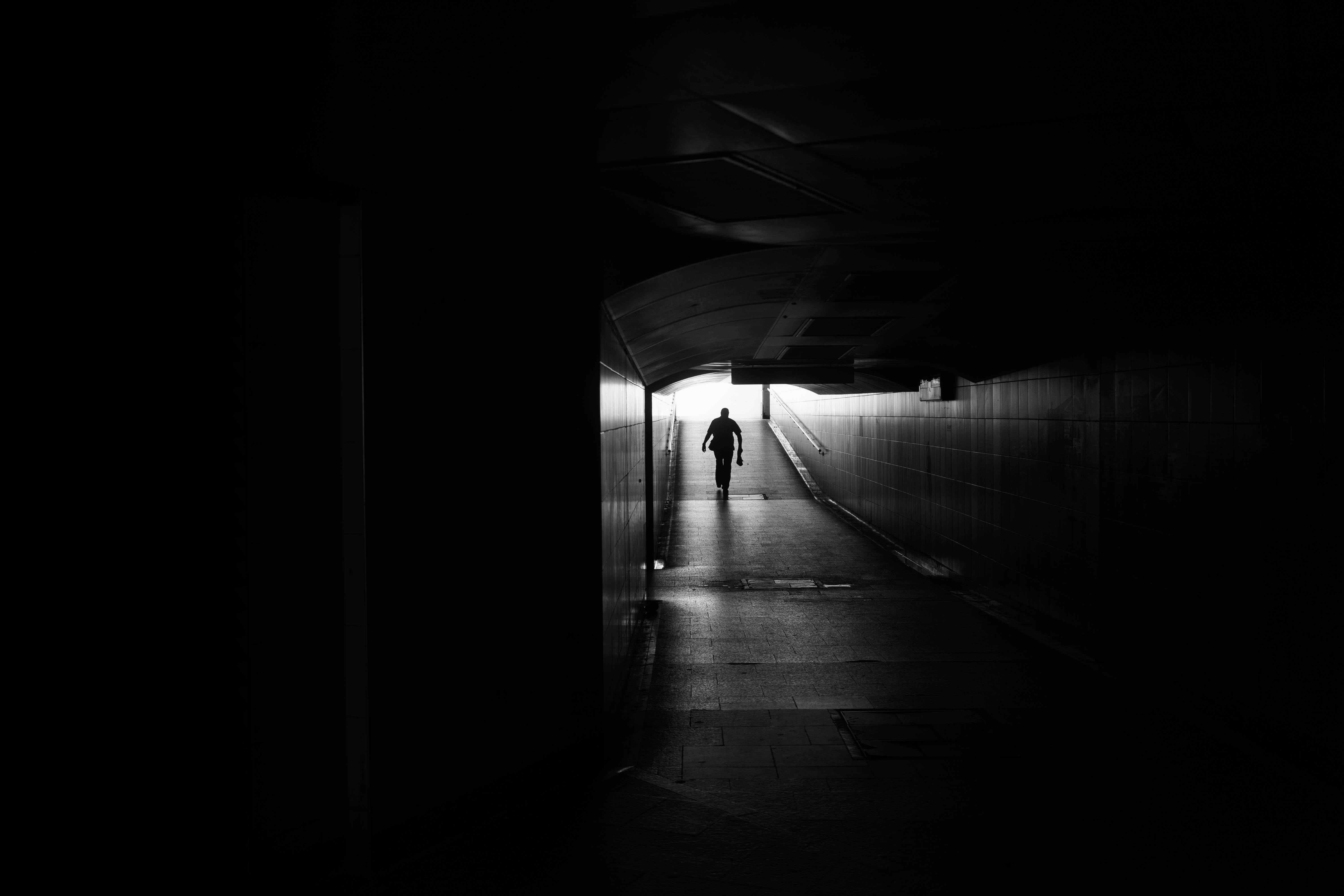 person walking in subway